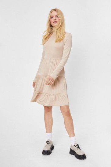 Light sand On a High Neck Tiered Mini Dress
