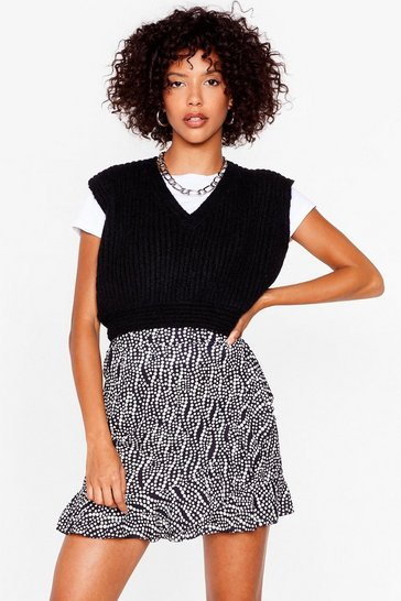 Black distorted polka dot ruffle wrap mini skirt