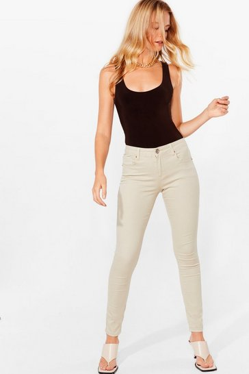Oyster button in stretch skinny jeans
