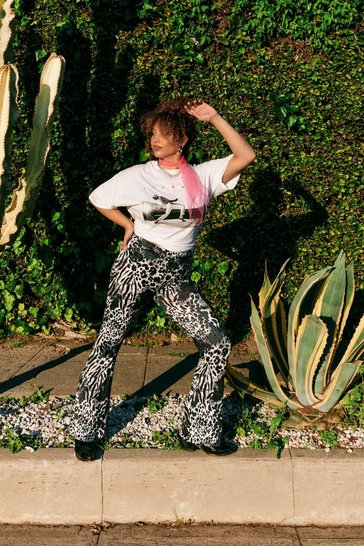 Black Wild Wild World Plus Animal Flare Trousers