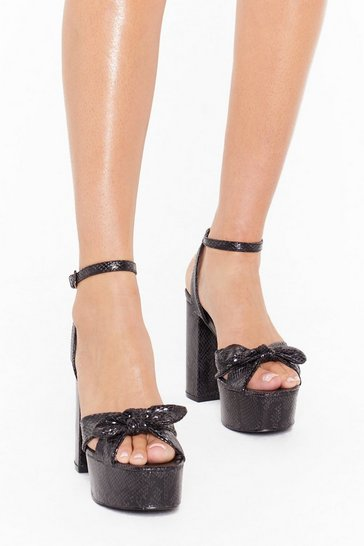 Womens Black Take a Bow Platform Snake Heels