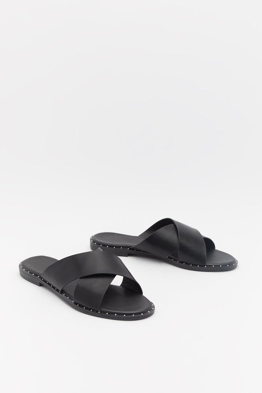 Cross Strap Stud Rand Flat Mules by Nasty Gal