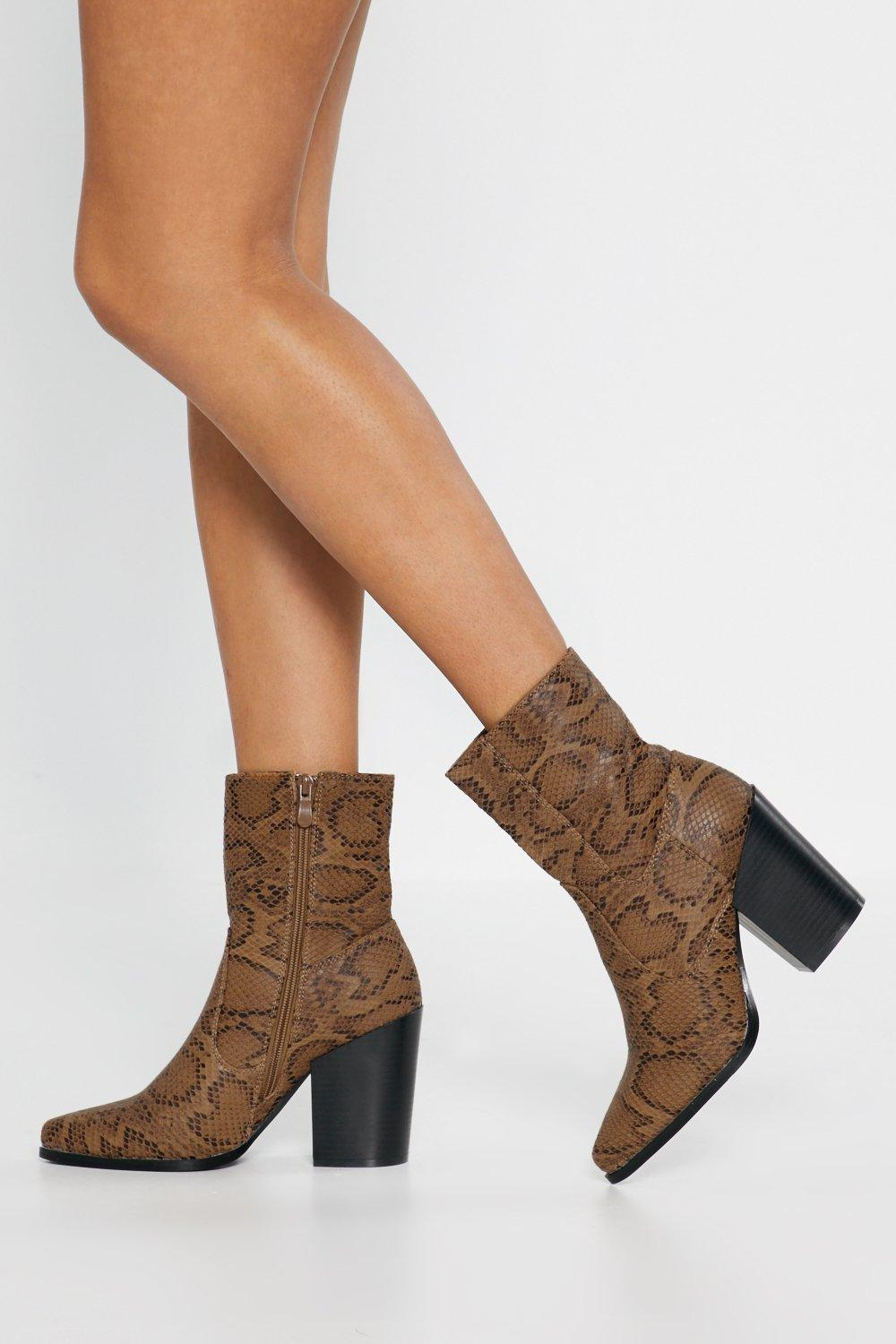 Snake Print Heeled Boots by Nasty Gal