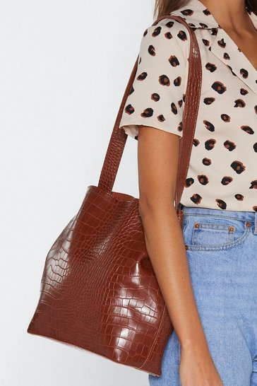 Brown WANT Wait for the Reveal Croc Clutch and Tote Bag