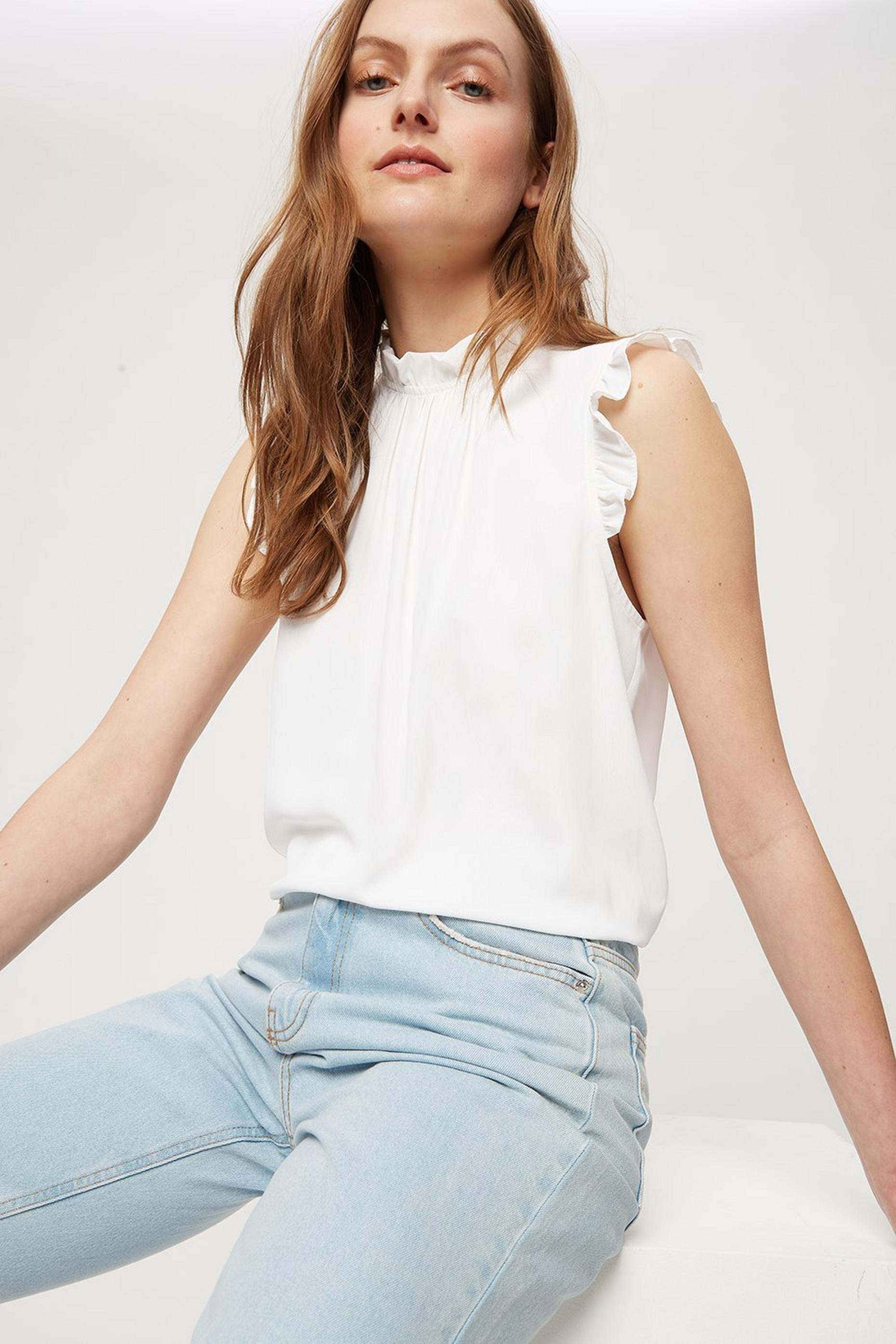 Ivory Ruffle Shell Top