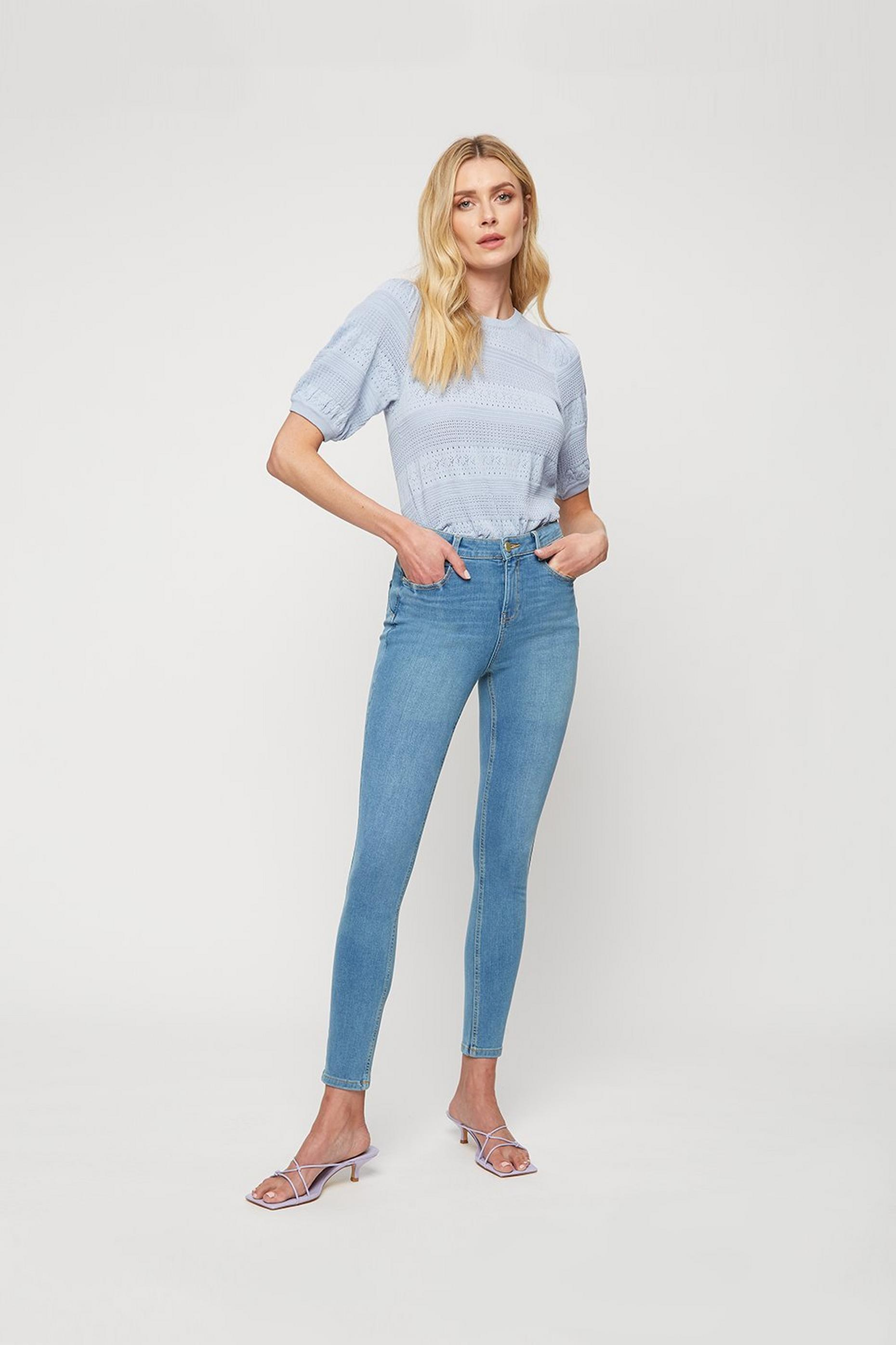 Light Wash Raw Hem 4 Way Stretch Jean